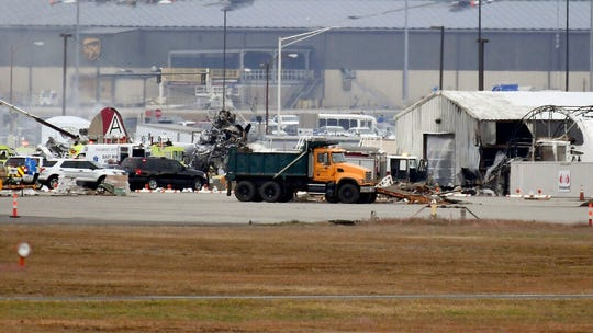 A fire-and-rescue operation is underway where World War II-era bomber plane crashed at Bradley International Airport in Windsor Locks, Conn., Wednesday, Oct. 2, 2019.