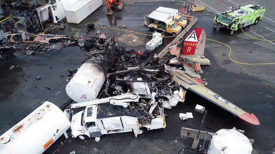 This image taken from video provided by National Transportation Safety Board shows damage from a World War II-era B-17 bomber plane that crashed Wednesday at Bradley International Airport, Thursday, Oct. 3, 2019 in Windsor Locks, Conn.  The plane crashed and burned after experiencing mechanical trouble on takeoff Wednesday morning from Bradley International Airport.