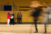 People walk past European Commission headquarters in Brussels, Friday, Oct. 4, 2019. A document read aloud in a Scottish court says British Prime Minister Boris Johnson would seek an extension to the Oct. 31 Brexit deadline if no withdrawal deal with the European Union is reached by mid-October.
