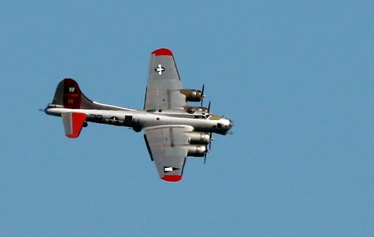 In this June 6, 2016 file photo, a World War II-era Boeing B-17 Flying Fortress airplane banks in the air as it comes in for a landing in Seattle on the anniversary of D-Day.
