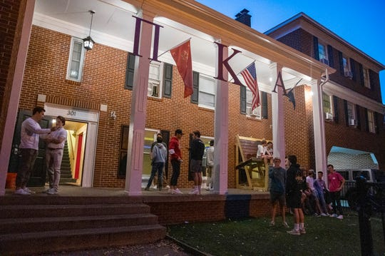 Pi Kappa Alpha fraternity members and pledges at Michigan State University hang out at the fraternity house during Greek Rush on Sept. 26, 2019 in  East Lansing.