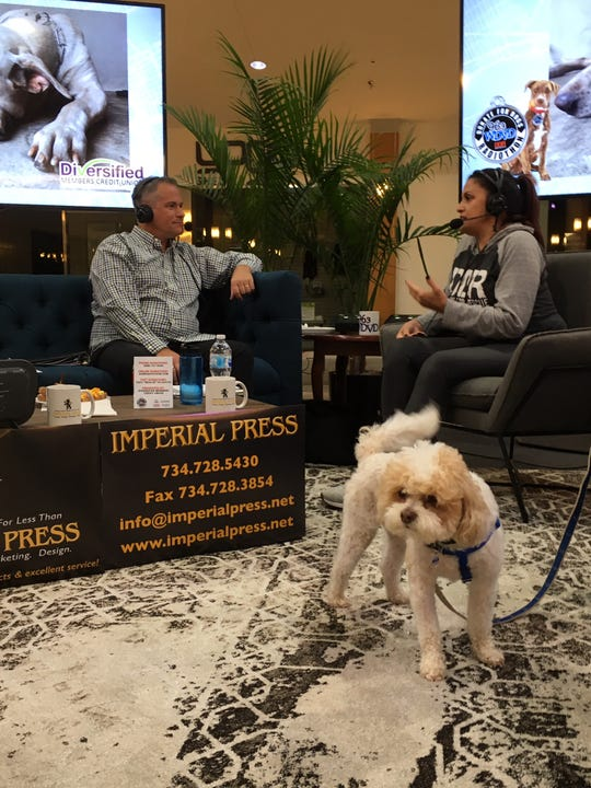WDVD-FM morning host Blaine Fowler  chats with Lucy Cruz of Rochester Hills, who adopted Coconut from Detroit Dog Rescue. The station's radiothon for the rescue organization runs until 7 p.m. at Orchard Mall in West Bloomfield.
