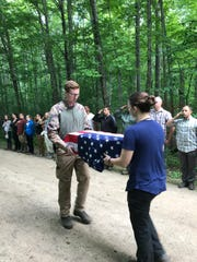 The Air Force Office of Special Investigations Cold Case Team and law enforcement partners depart the forest where Sgt. Donald Rexroth's remains were recovered.