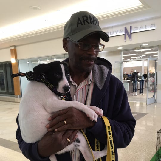 Edgar Johnson, 75, of Detroit was so taken by 14-week-old Zuckey at the Detroit Dog Rescue radiothon that he adopted the pup.