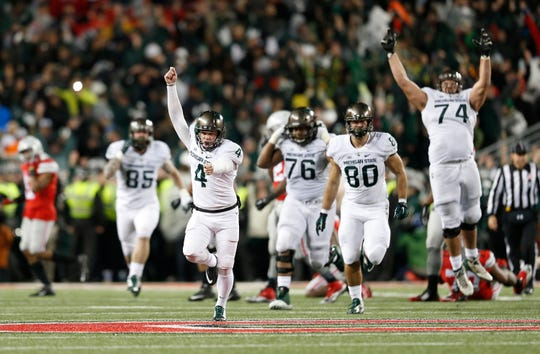 Michigan State kicker Michael Geiger  celebrates a 41-yard field goal as time expires to beat Ohio State 17-15 on Nov. 21, 2015, in Columbus, Ohio.