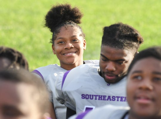 Detroit Southeastern High School football player Azia Isaac and teammates listen to instructions during practice Thursday.