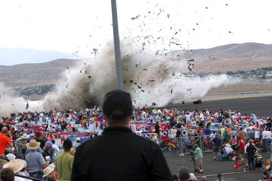 In this Sept. 16, 2011, file photo, a P-51 Mustang airplane crashes into the edge of the grandstands at the Reno Air show in Reno, Nev.