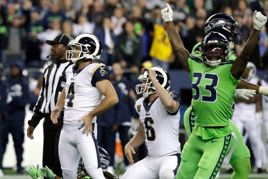 Los Angeles Rams kicker Greg Zuerlein (4) and Seattle Seahawks free safety Tedric Thompson (33) react after Zuerlein missed a field goal in the final seconds on Thursday.