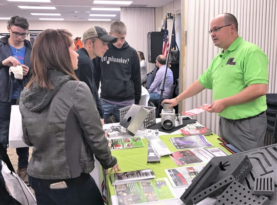 Bob Thomas, marketing manager for EL Manufacturing in Horseheads, talks with students about his company's products during Friday's Made in the Southern Tier expo at the Greater Southern Tier BOCES campus.