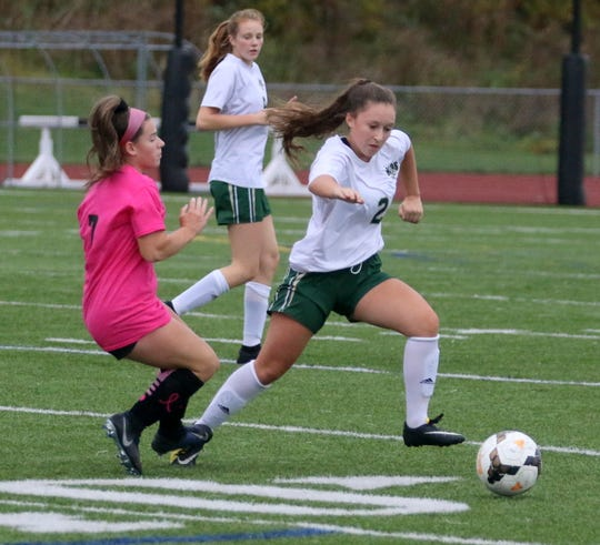 Vestal's Ella Newton (2) tries to get around Elmira's Tierney Krawczyk in girls soccer Oct. 3, 2019 at Ernie Davis Academy.
