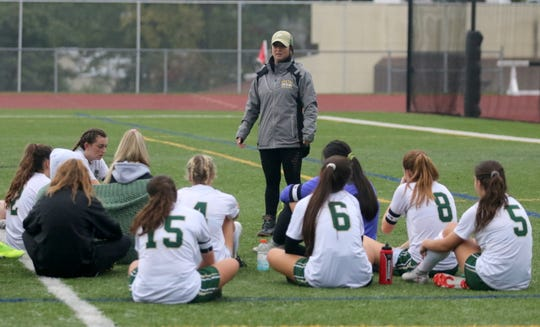 Vestal head coach Gina Baldwin talks to her team at halftime of a 1-1 tie against Elmira on Oct. 3, 2019 at Ernie Davis Academy.