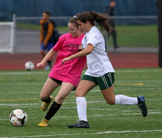 Mandy McCarrick of Elmira, left, and Vestal's Alexia Michitti battle for possession during a 1-1 tie in girls soccer Oct. 3, 2019 at Ernie Davis Academy.