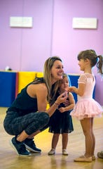 Kelly Sigler, owner and instructor, interacts with dance students Aria Ackerman and Makenley Wells.