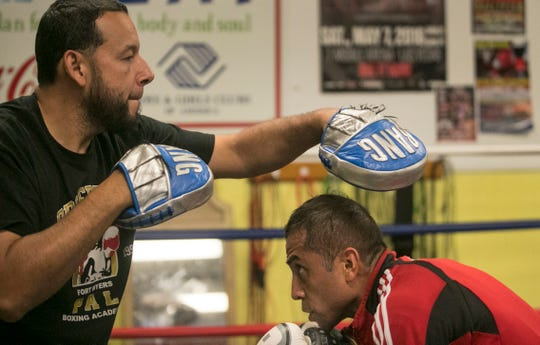 Carlos David Arce, right, trains with his coach Jose Ojeda of the Police Athletic League Boxing Academy on Thursday, October 4, 2019, in Fort Myers. Arce, 37, is trying to make the Olympic boxing team. His next step is Sunday is Columbus, Ohio.