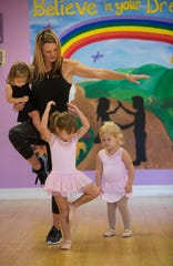 "At a recent expressive dance class for tiny tots, Kelly Sigler led  a series of imaginative warmups, including ""tinker bell claps"" and putting on princess makeup."