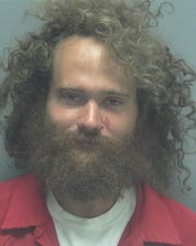 John Hennessey was found guilty Oct. 3 on multiple charges related to a 2018 incident where he danced around a fire naked, covered in blood and attacked officers with a stick.