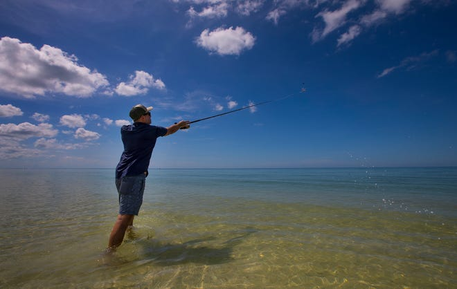 Naples resident Ryan Lackey enjoys a pleasant morning fishing off Barefoot Beach in Bonita Springs, Friday, October 4, 2019. Despite the beautiful beach weather, Red tide is lurking off Lee and Collier counties, and concentrations are high enough to potentially cause fish kills and breathing issues in humans.