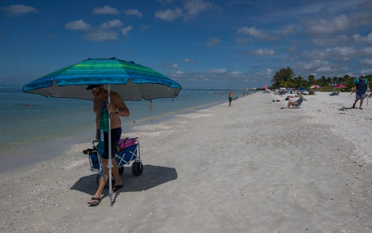 Jeff Graham, of Oklahoma, visits Barefoot Beach in Bonita Springs, Friday, October 4, 2019. Red tide is lurking off Lee and Collier counties, and concentrations are high enough to potentially cause fish kills and breathing issues in humans.