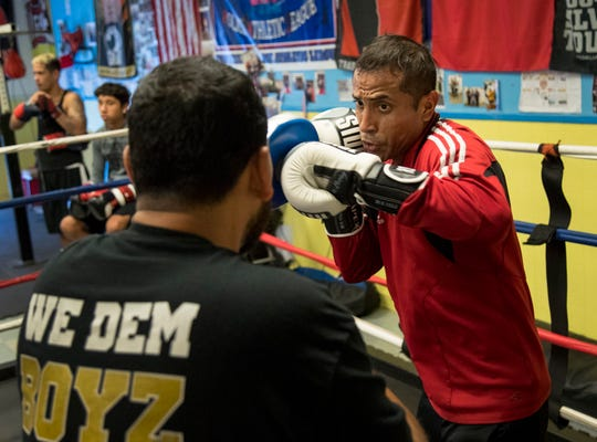 "Carlos David Arce, right, trains with his coach Jose Ojeda of the Police Athletic League Boxing Academy on Thursday, October 4, 2019, in Fort Myers. Arce, 37, is trying to make the Olympic boxing team. His next step is Sunday is Columbus, Ohio. ""Getting in the ring makes me happy. It gives me peace,"" said Arce."