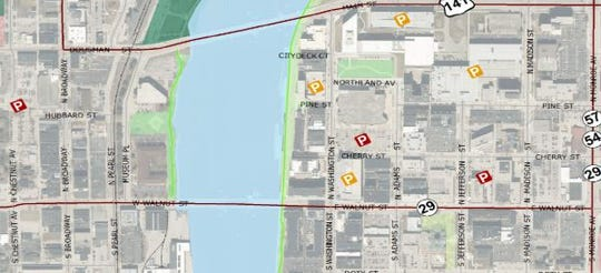 A map of downtown Green Bay shows parking garages (yellow) and surface lots (red) where you can safely park overnight without restrictions.