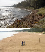 The beach at Whitefish Dunes State Park has virtually disappeared as Lake Michigan's water levels rose. The view today, top, is dramatically different from how it looked in 2001, below.