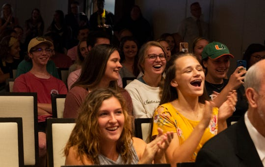 Audience members react to the announcement at Anderson University's G. Ross Anderson Jr. Student Center Friday, Oct. 4, 2019 that the university is planning to start a football program.