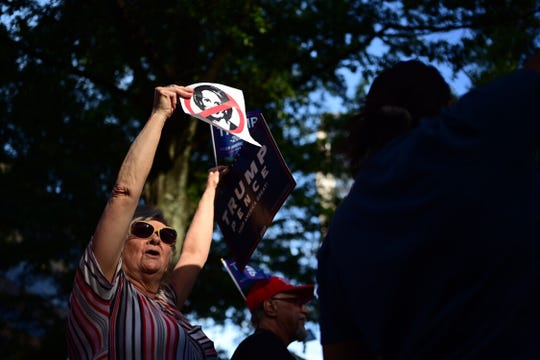 Myrtle Cox protests outside the Hyatt in downtown Greenville ahead of Speaker of the House Nancy Pelosi's visit on Friday, Oct. 4, 2019.