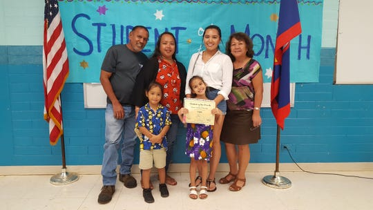 The Guahan Academy Charter School honored its August Student of the Month awardees on Sept. 26 Pictured from front row: SkyeAvry Blas and Ha'ani Tainatongo-Yarbrough. Back row from left: Marvin & Joyce Reyes; Shaytasha Tainatongo-Yarbrough and Teresita Cruz, CRT Guahan Academy Charter School.