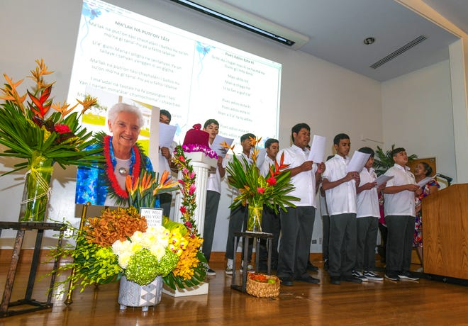Members of the Father Duenas Memorial School choir lead guests and others in song during a memorial service held for Marjorie Driver at the University of Guam in Mangilao on Friday, Oct. 4, 2019. Driver was a co-founder of the Richard Flores Taitano Micronesian Area Research Center, commonly referred to as MARC, which serves as the primary repository of Micronesian history, knowledge, and cultural preservation in our region, according to a UOG website.