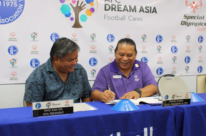 Guam Football Association President Tino San Gil, left, and Special Olympics Guam President and CEO Frank Florig sign a Memorandum of Agreement during a press conference Oct. 4 at the GFA National Training Center announcing the creation of Unified Soccer for all athletes, in line with Special Olympics International's inclusion movement evolution.
