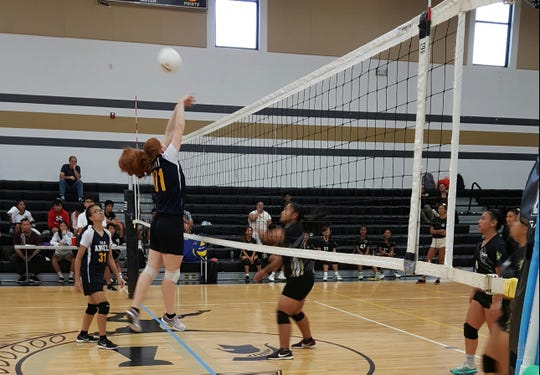 Guam Adventist Academy Angels'Micaela Moffit looks for a block against the Tiyan High Titans in IIAAG Girls Volleyball Wednesday at the Tiyan High gym.