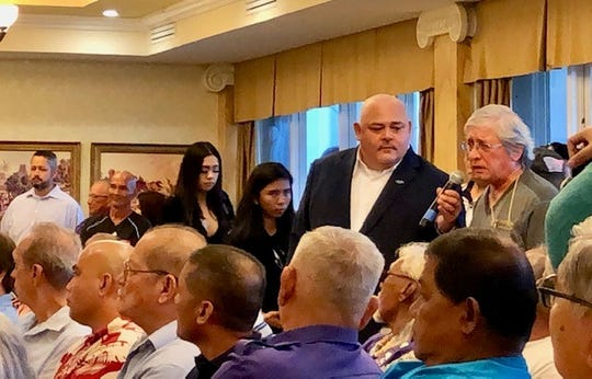 A veteran poses a question to visiting members of the House Veterans Affairs Committee during a packed veterans town hall on Oct. 4, 2019 at the Government House.