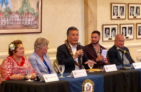 House Veterans Affairs Committee Chair Rep. Mark Taitano, center, answers a question while other members of the congressional delegation look on during a packed Oct. 4, 2019 veterans town hall at Government House.