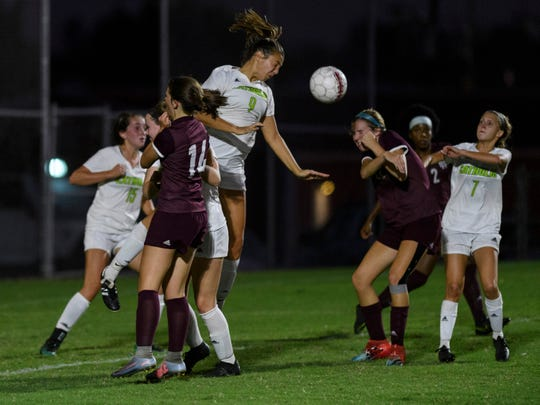 Owensboro Catholic's Lily Moore (9) heads the ball away from the net during a Henderson Lady Colonels corner kick attempt in the first half at Colonel Field in Henderson, Ky., Thursday, Oct. 3, 2019. The Colonels fell 2-1 to the Lady Aces.