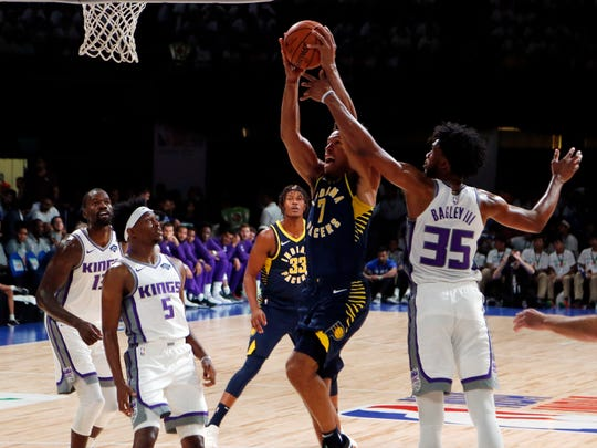 The Pacers Malcolm Brogdon aims for the net during a match against Sacramento Kings on Friday at the NBA India Games 2019 in Mumbai, India. (AP Photo/Rajanish Kakade)
