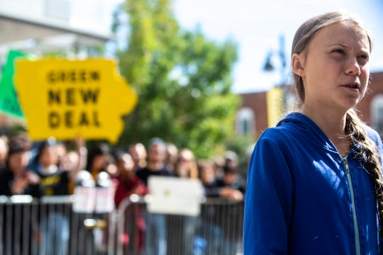 "Climate activist Greta Thunberg speaks with reporters after the climate strike for a ""Town-Gown Climate Accord"" hosted by the Iowa City Climate Strikers, Friday, Oct., 4, 2019, at the intersection of Dubuque Street and Iowa Avenue in downtown Iowa City, Iowa."