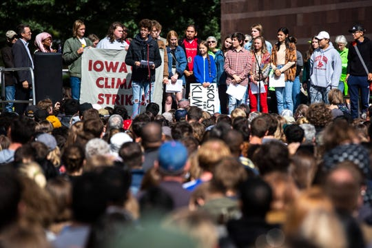 "Massimo Biggers, 14, of Iowa City, introduces climate activist Greta Thunberg during the ""Town-Gown Climate Accord"" hosted by the Iowa City Climate Strikers, Friday, Oct., 4, 2019, at the intersection of Dubuque Street and Iowa Avenue in downtown Iowa City, Iowa."