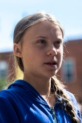 "Climate activist Greta Thunberg speaks with reporters during the ""Town-Gown Climate Accord"" hosted by the Iowa City Climate Strikers, Friday, Oct., 4, 2019, at the intersection of Dubuque Street and Iowa Avenue in downtown Iowa City, Iowa."