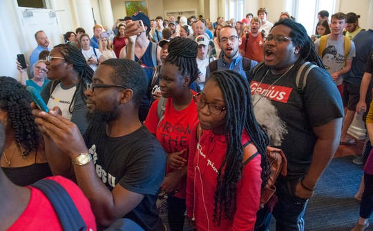 University of Mississippi students protest outside a meeting at The Inn at Ole Miss to announce Glenn Boyce officially the new chancellor of the university Friday, Oct. 4, 2019. Filled to capacity and with protests both inside and out, the meeting was called off  and University Police Chief Ray Hawkins told protesters they needed to leave the Inn at Ole Miss premises and move the protest elsewhere. The protest continues for a short time at outside the Ole Miss Lyceum.