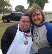 Debbie Riffle and Jordan St. John take a picture before walking in last year's Buddy Walk.