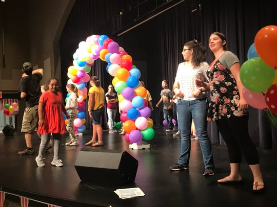 Alayna Gilley, right, and Haven Jordansen dance with other students in the Best Buddies program at South Gibson County High School on Sept. 30, 2019.