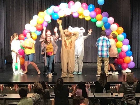 Students in South Gibson's Best Buddies program dance on stage at the match party on Sept. 30, 2019.