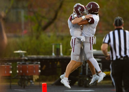 Bearden High School quarterback Collin Ironside (2) and receiver Hayden Candela (1) celebrate a touchdown during the game against Hardin Valley on Oct. 3, 2019 – the Bulldogs' first win after starting the season 0-5.