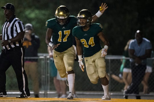 Catholic's Kaden Martin (17) and Catholic's Luke Davenport (34) celebrate a touchdown during a game between Knoxville Catholic and Brentwood Academy at Knoxville Catholic, Thursday, Oct. 3, 2019. Catholic defeated Brentwood Academy 42-37.