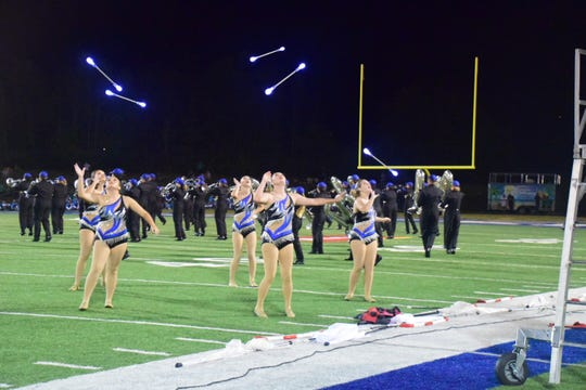 Karns High School baton twirlers lit up the night with glowing batons.