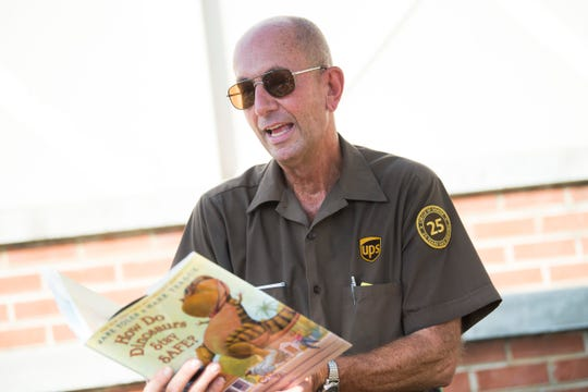 David Giles, a UPS driver of 30 years, reads to children and their parents at the Parents as Teachers sponsored Roll & Read at Safety City in Knoxville Friday, Oct. 4, 2019.