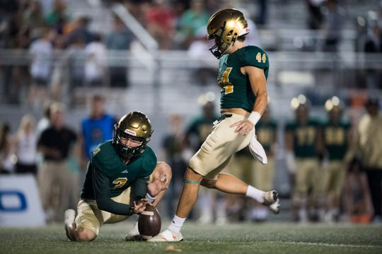 Catholic's Jack Jancek (3) holds the ball for Paxton Robertson (44) during a game between Knoxville Catholic and Brentwood Academy at Knoxville Catholic, Thursday, Oct. 3, 2019.