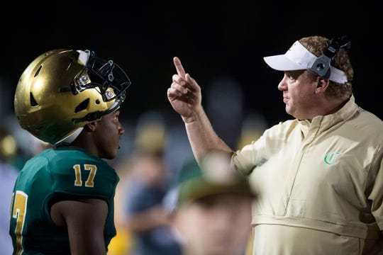 Knoxville Catholic head coach Steve Matthews speaks to Kaden Martin (17) during the game against Brentwood Academy on Thursday, Oct. 3, 2019.