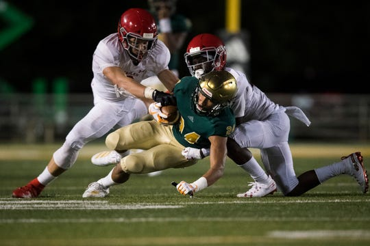 Catholic's Tommy Winton (24) is taken down by Brentwood Academy players during a game between Knoxville Catholic and Brentwood Academy at Knoxville Catholic, Thursday, Oct. 3, 2019.
