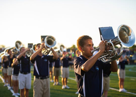 Hardin Valley band members play the national anthem before the Hardin Valley and Bearden high school football game on Thursday, October 3, 2019 at Hardin Valley Academy.